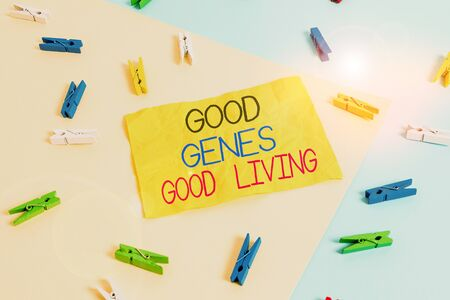 Handwriting text writing Good Genes Good Living. Conceptual photo Inherited Genetic results in Longevity Healthy Life Colored clothespin paper empty reminder yellow blue floor background office
