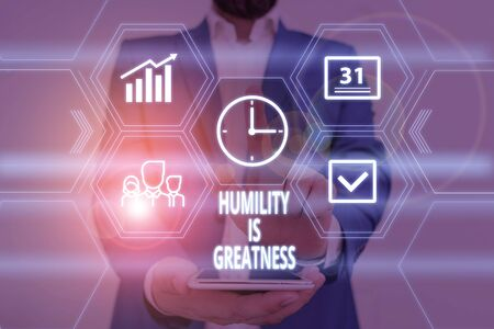 Text sign showing Humility Is Greatness. Business photo showcasing being Humble is a Virtue not to Feel overly Superior Male human wear formal work suit presenting presentation using smart device Banco de Imagens