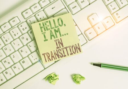 Writing note showing Hello I Am In Transition. Business concept for Changing process Progressing planning new things Green note paper with pencil on white background and pc keyboard