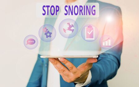 Handwriting text writing Stop Snoring. Conceptual photo noisy breathing during sleep due to vibrating airway tissue Male human wear formal work suit presenting presentation using smart device