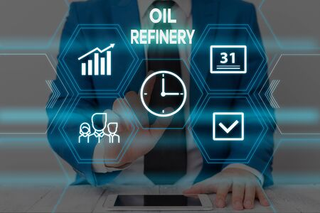 Text sign showing Oil Refinery. Business photo text industrial process of converting crude oil into petroleum Male human wear formal work suit presenting presentation using smart device