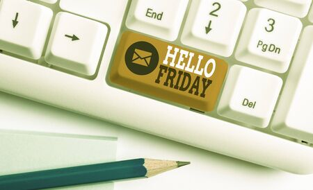 Conceptual hand writing showing Hello Friday. Concept meaning Greetings on Fridays because it is the end of the work week White pc keyboard with note paper above the white background