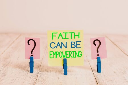 Conceptual hand writing showing Faith Can Be Empowering. Concept meaning Trust and Believing in ourselves that we can do it Crumbling sheet with paper clips placed on the wooden table Banque d'images