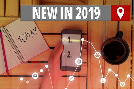 Writing note showing New In 2019. Business concept for what will be expecting or new creation for the year 2019 版權商用圖片