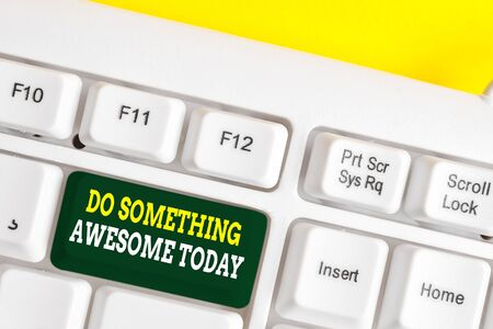 Word writing text Do Something Awesome Today. Business photo showcasing Make an incredible action motivate yourself White pc keyboard with empty note paper above white background key copy space