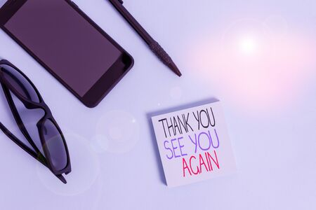 Handwriting text writing Thank You See You Again. Conceptual photo Appreciation Gratitude Thanks I will be back soon Eyeglasses colored sticky note smartphone cell pen cool pastel background
