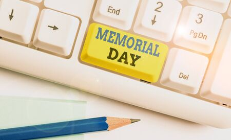 Word writing text Memorial Day. Business photo showcasing remembering the military demonstratingnel who died in service White pc keyboard with empty note paper above white background key copy space