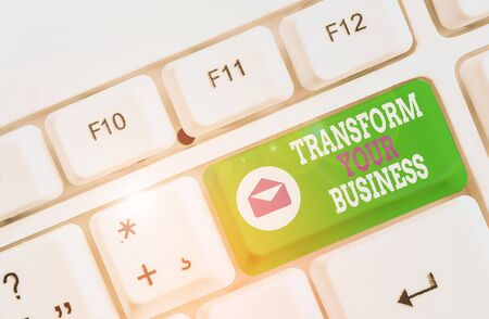 Word writing text Transform Your Business. Business photo showcasing Modify energy on innovation and sustainable growth White pc keyboard with empty note paper above white background key copy space
