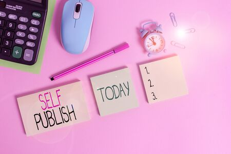 Conceptual hand writing showing Self Publish. Concept meaning published their work independently and at their own expense Notepads alarm clock calculator sheet marker colored background
