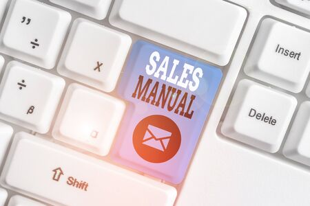 Conceptual hand writing showing Sales Manual. Concept meaning set of printed materials containing product descriptions White pc keyboard with note paper above the white background