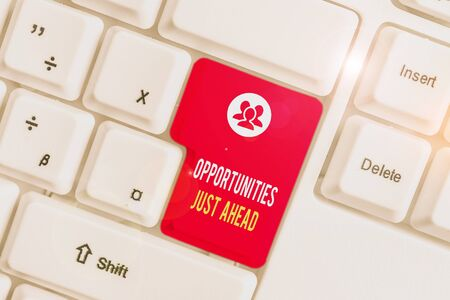 Text sign showing Opportunities Just Ahead. Business photo text Advantageous circumstances Perseverance pays off White pc keyboard with empty note paper above white background key copy space