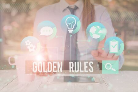 Handwriting text writing Golden Rules. Conceptual photo basic principle that should always follow to ensure success Female human wear formal work suit presenting presentation use smart device