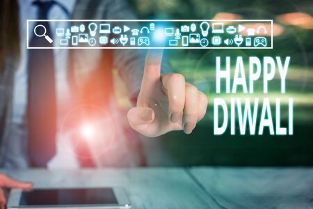 Writing note showing Happy Diwali. Business concept for festival of lights that celebrated by millions of Hindus Woman wear formal work suit presenting presentation using smart device