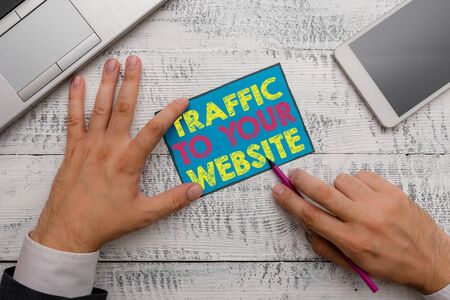 Writing note showing Traffic To Your Website. Business concept for Lifeblood of online business more Potential Leads Stock Photo