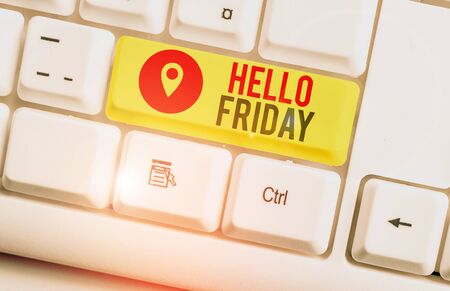 Text sign showing Hello Friday. Business photo showcasing Greetings on Fridays because it is the end of the work week White pc keyboard with empty note paper above white background key copy space Imagens