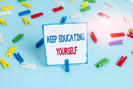 Conceptual hand writing showing Keep Educating Yourself. Concept meaning dont stop studying Improve yourself using Courses Colored clothespin papers empty reminder blue floor officepin