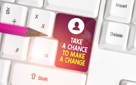 Conceptual hand writing showing Take A Chance To Make A Change. Concept meaning dont lose opportunity to reach bigger things White pc keyboard with note paper above the white background