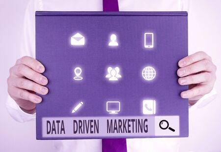 Text sign showing Data Driven Marketing. Business photo text Strategy built on Insights Analysis from interactions Male human holding thick textured cardboard of business promotion concept Stock Photo