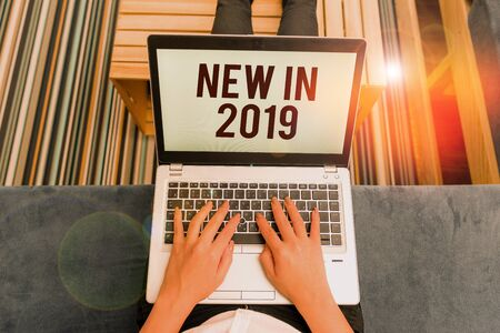 Writing note showing New In 2019. Business concept for what will be expecting or new creation for the year 2019 woman laptop computer office supplies technological devices inside home 版權商用圖片