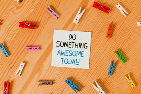 Writing note showing Do Something Awesome Today. Business concept for Make an incredible action motivate yourself Colored clothespin papers empty reminder wooden floor background office Stock fotó