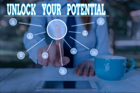 Word writing text Unlock Your Potential. Business photo showcasing improve self awareness Skills to Achieve more Woman wear formal work suit presenting presentation using smart device