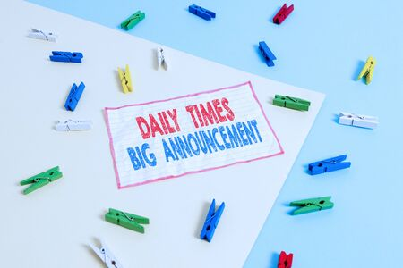 Conceptual hand writing showing Daily Times Big Announcement. Concept meaning bringing actions fast using website or tv Colored clothespin paper reminder with yellow blue background Stock fotó