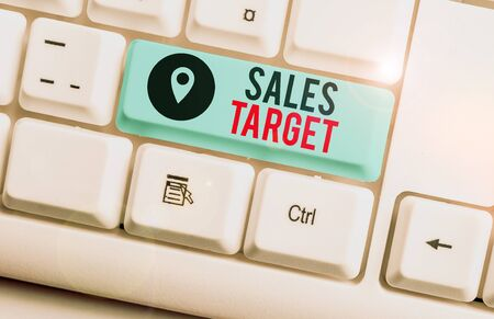 Text sign showing Sales Target. Business photo text specified amount of sales that a analysisagement sets for achieving White pc keyboard with empty note paper above white background key copy space