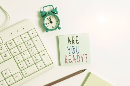Conceptual hand writing showing Are You Ready Question. Concept meaning Setting oneself on the activity Being Prepared Keyboard with empty note paper and pencil white background