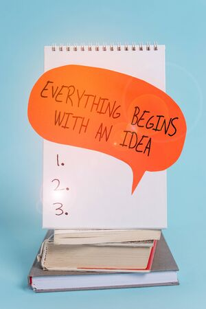 Writing note showing Everything Begins With An Idea. Business concept for steps you take to turn an idea into a reality Spiral notebook speech bubble stacked old books cool pastel background