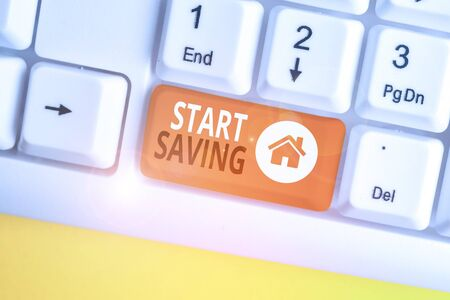 Conceptual hand writing showing Start Saving. Concept meaning money that a demonstrating keeps in an account in a bank or like White pc keyboard with note paper above the white background