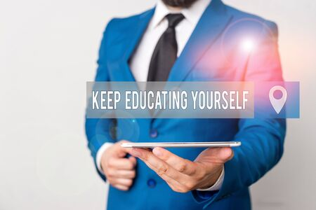 Writing note showing Keep Educating Yourself. Business concept for dont stop studying Improve yourself using Courses Businessman in blue suite with a tie holds lap top in hands
