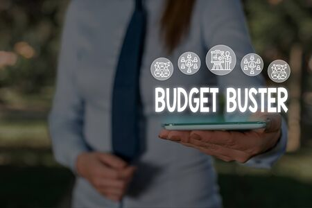 Conceptual hand writing showing Budget Buster. Concept meaning Carefree Spending Bargains Unnecessary Purchases Overspending Woman wear work suit presenting presentation smart device