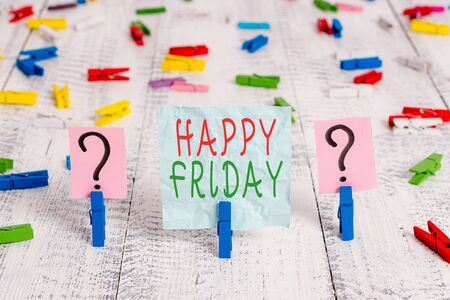 Conceptual hand writing showing Happy Friday. Concept meaning Greetings on Fridays because it is the end of the work week Crumbling sheet with paper clips placed on the wooden table