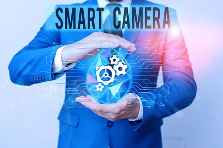 Conceptual hand writing showing Smart Camera. Concept meaning individual image processing systems designed to automate Male human wear formal suit presenting using smart device Stock Photo