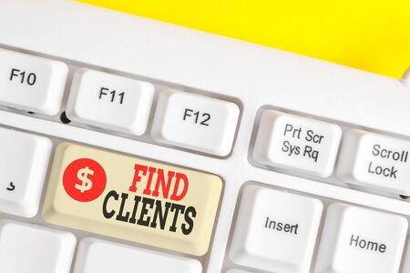 Text sign showing Find Clients. Business photo showcasing to identify or looking for a potential customers or leads White pc keyboard with empty note paper above white background key copy space 版權商用圖片