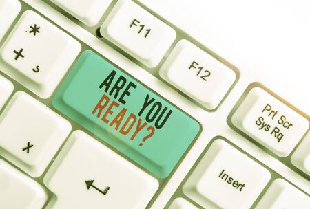 Handwriting text writing Are You Ready Question. Conceptual photo Setting oneself on the activity Being Prepared White pc keyboard with empty note paper above white background key copy space