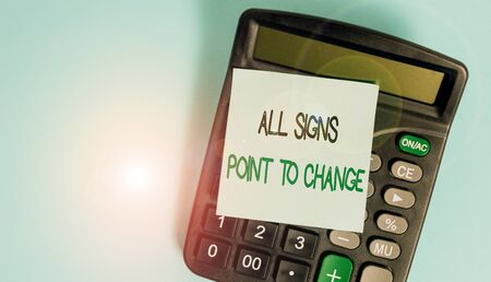 Text sign showing All Signs Point To Change. Business photo showcasing Necessity of doing things differently new vision Portable electronic calculator device blank sticky note colored background