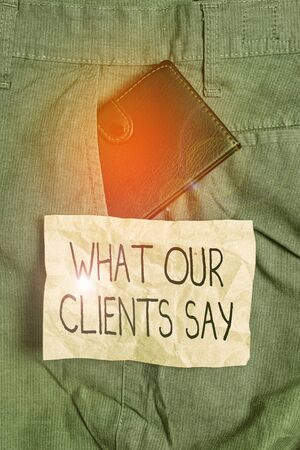 Word writing text What Our Clients Say. Business photo showcasing testimonials or feedback of aclient about the product Small little wallet inside man trousers front pocket near notation paper