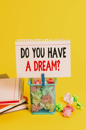 Handwriting text Do You Have A Dream Question. Conceptual photo asking someone about life goals Achievements Trash bin crumpled paper clothespin empty reminder office supplies yellow Archivio Fotografico