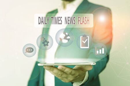 Conceptual hand writing showing Daily Times News Flash. Concept meaning fast response to actions happened in article way Male human wear formal suit presenting using smart device Stock fotó