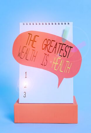 Writing note showing The Greatest Wealth Is Health. Business concept for being in good health is the prize Take care Spiral notepad box speech bubble arrow banners cool colored background