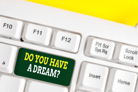 Word writing text Do You Have A Dream Question. Business photo showcasing asking someone about life goals Achievements White pc keyboard with empty note paper above white background key copy space Stock Photo