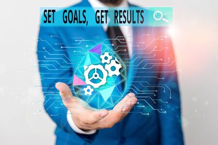 Word writing text Set Goals Get Results. Business photo showcasing Establish objectives work for accomplish them Male human wear formal work suit presenting presentation using smart device Stok Fotoğraf
