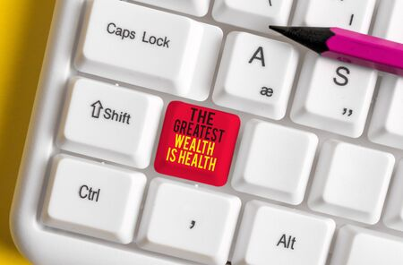 Text sign showing The Greatest Wealth Is Health. Business photo text being in good health is the prize Take care White pc keyboard with empty note paper above white background key copy space
