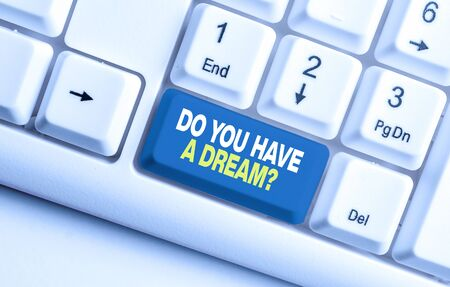 Handwriting text Do You Have A Dream Question. Conceptual photo asking someone about life goals Achievements White pc keyboard with empty note paper above white background key copy space