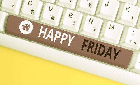 Writing note showing Happy Friday. Business concept for Greetings on Fridays because it is the end of the work week White pc keyboard with note paper above the white background