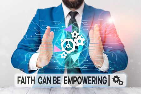 Text sign showing Faith Can Be Empowering. Business photo showcasing Trust and Believing in ourselves that we can do it Male human wear formal work suit presenting presentation using smart device