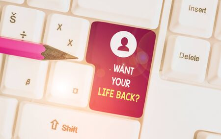 Conceptual hand writing showing Want Your Life Back Question. Concept meaning Have again our Lives Take Control of our Being White pc keyboard with note paper above the white background 写真素材