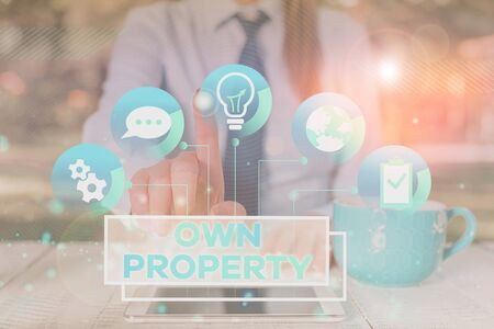 Word writing text Own Property. Business photo showcasing Things that you own and can take it with you Movable Tangible Female human wear formal work suit presenting presentation use smart device Reklamní fotografie