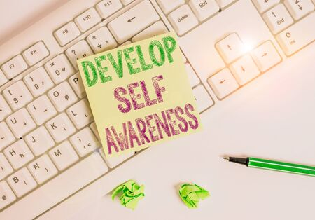 Writing note showing Develop Self Awareness. Business concept for increase conscious knowledge of own character Green note paper with pencil on white background and pc keyboard